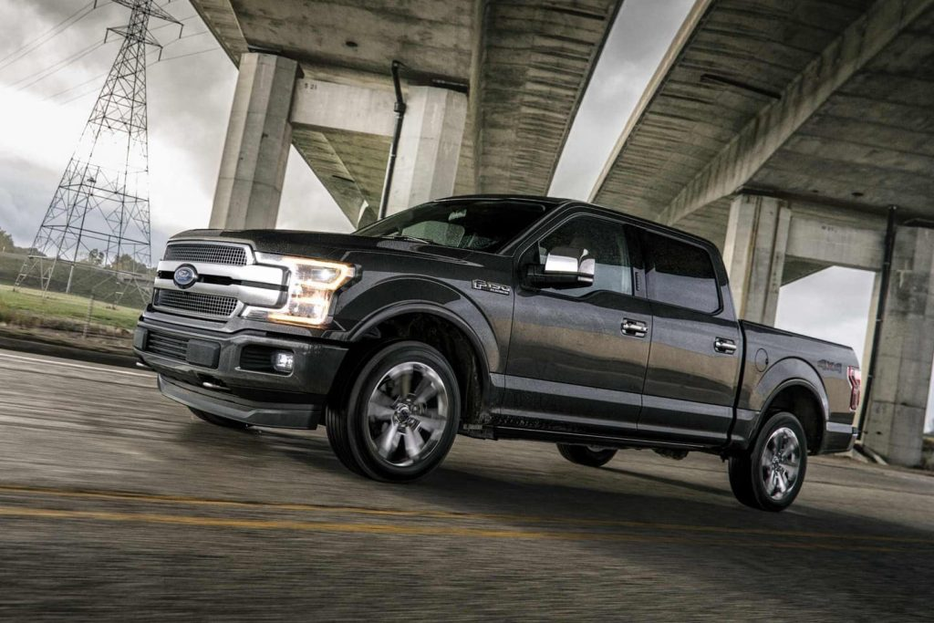 F-150 Platinum parked under a bridge